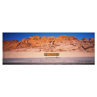 Bench in front of rocks, Red Rock Canyon State Par Poster