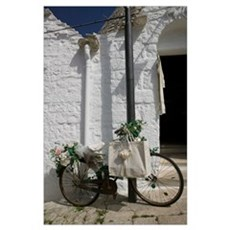 Bicycle parked against a pole, Trulli House, Alber Poster