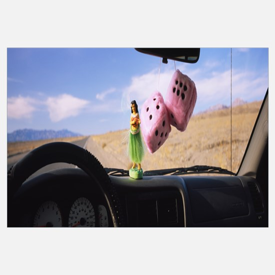 Fuzzy dices hanged on a rear view mirror with a hu