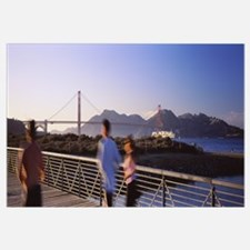 Rear View Of Three People Jogging On A Bridge, Gol