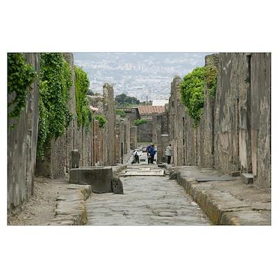 Tourists at old ruins, via di Mercurio, Pompeii, N Poster