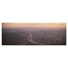 Aerial view of a city at dawn looking towards Los  Poster