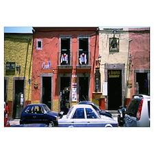 Cars on road in front of buildings, San Miguel De