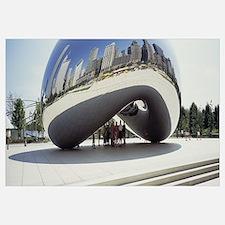 Tourist standing under a sculpture, Cloud Gate, Mi