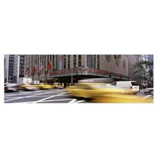 Cars in front of a building, Radio City Music Hall Framed Print