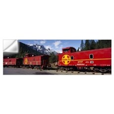 Freight train on railroad tracks in a national for Wall Decal