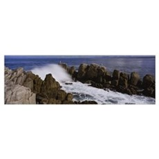 Rock formations in water, Pebble Beach, California Framed Print