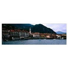 Buildings at the lakeside viewed from a ferry, Lak Framed Print