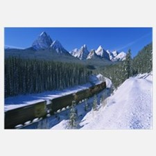 Train moving on a railroad track with a mountain r