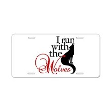 I run with wolves Aluminum License Plate