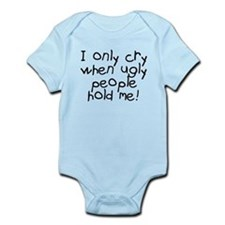 I only cry when ugly hold me Onesie