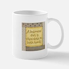 Cute A balanced diet is chocolate in both hands Mug