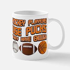 Hockey Players Use Pucks Mug