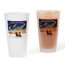 XmasSunrise/ 2 Dachshunds Drinking Glass