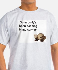 ferret-pooping-in-corner T-Shirt