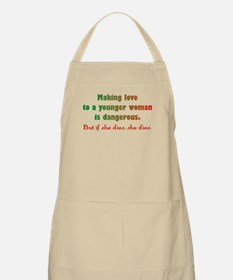 Making love to a young woman Apron