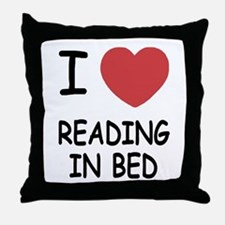 I heart reading in bed Throw Pillow