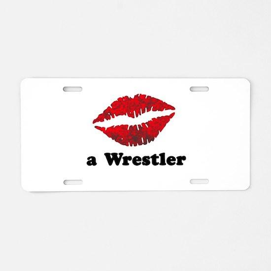 KissAWrestler.png Aluminum License Plate