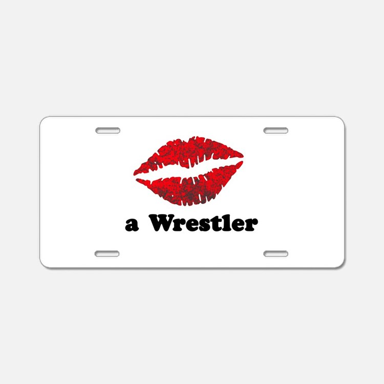 KissAWrestler.png Aluminum License Plate