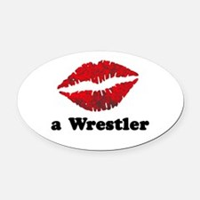 KissAWrestler.png Oval Car Magnet