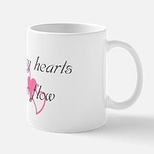 Into many hearts love can flo Mug