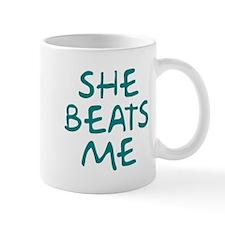 She Beats Me Mug