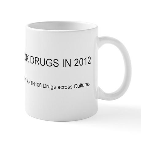 I took drugs in 2012 Black on white bkg Mugs