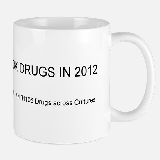 I took drugs in 2012 Black on white bkg Mugs