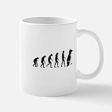 Humans evolve into penguins Mug
