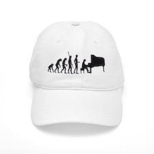 evolution piano player Baseball Cap