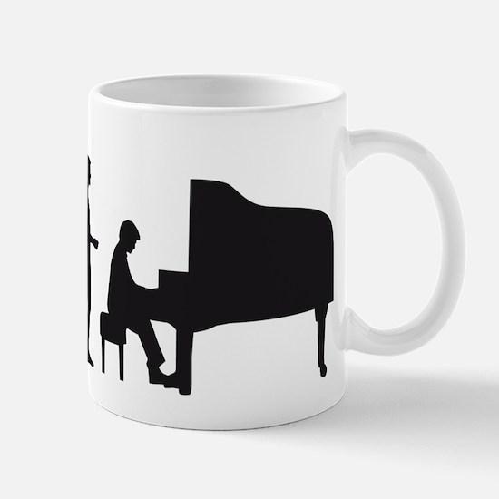 evolution piano player Mug