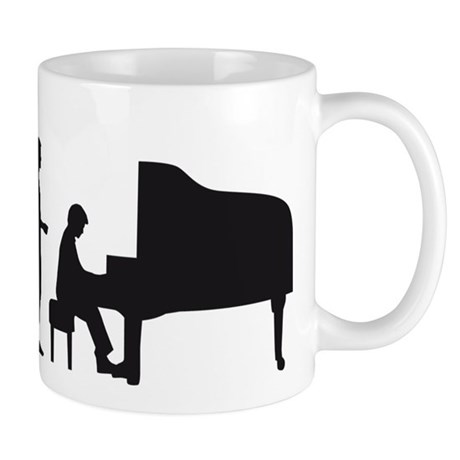 evolution piano player Mug
