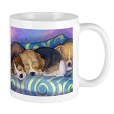 Beagle puppies asleep on the sofa Mug