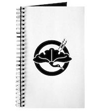 Crane-shaped ginkgo leaf on circle Journal