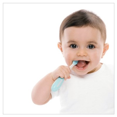 Baby boy with toothbrush Framed Print