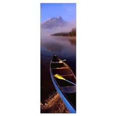 Canoe in lake in front of mountains, Leigh Lake, R Poster