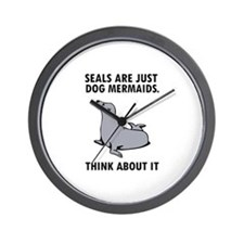 Seals are just dog mermaids. Wall Clock