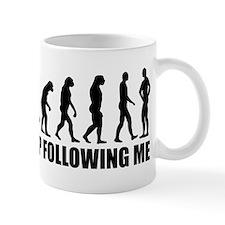 Stop following me evolution Mug