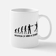 Evolution of man vs zombie Mug
