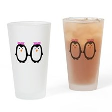 Two Female Penguins Drinking Glass