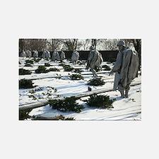 Korean war memorial veterans statues during snow R