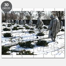 Korean war memorial veterans statues during snow P