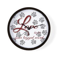 Love is a four legged word. Wall Clock