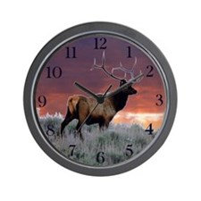 Bull elk at sunset Wall Clock