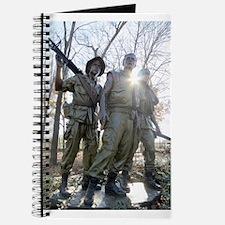 Vietnam war memorial three service men Journal