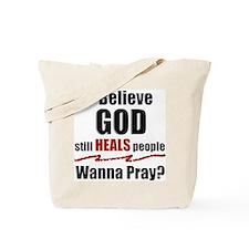 God Still Heals Tote Bag
