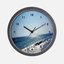 Wave Rolling Onto Beach Wall Clock
