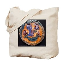 Moon face by Dana Graap. Tote Bag