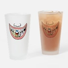 Behind a smile Drinking Glass