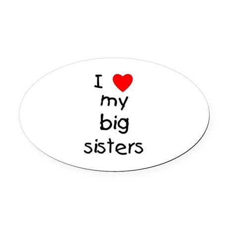 I Love My Big Sisters Oval Car Magnet